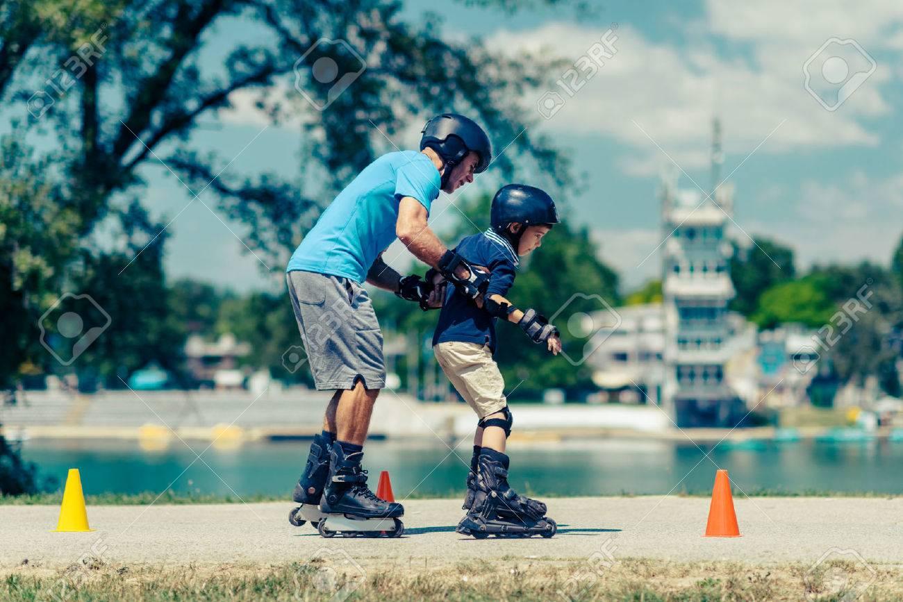 Roller skating class with senior teacher and little boy - 61106252