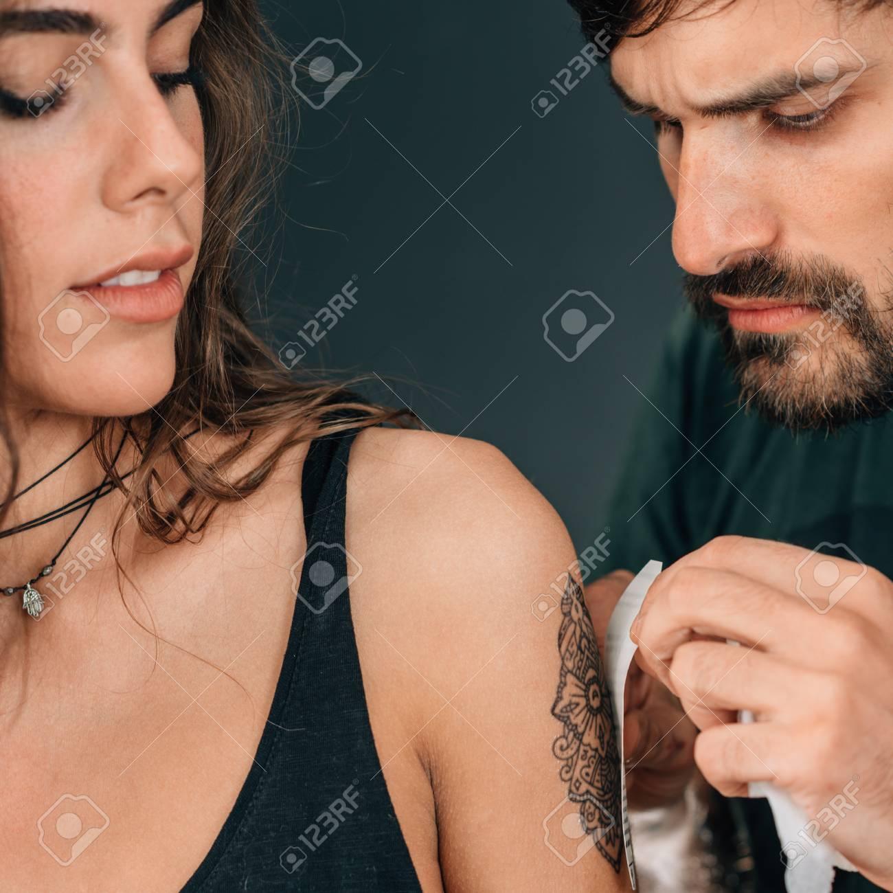 Temporary tattoo  Professional make-up artist applying temporary