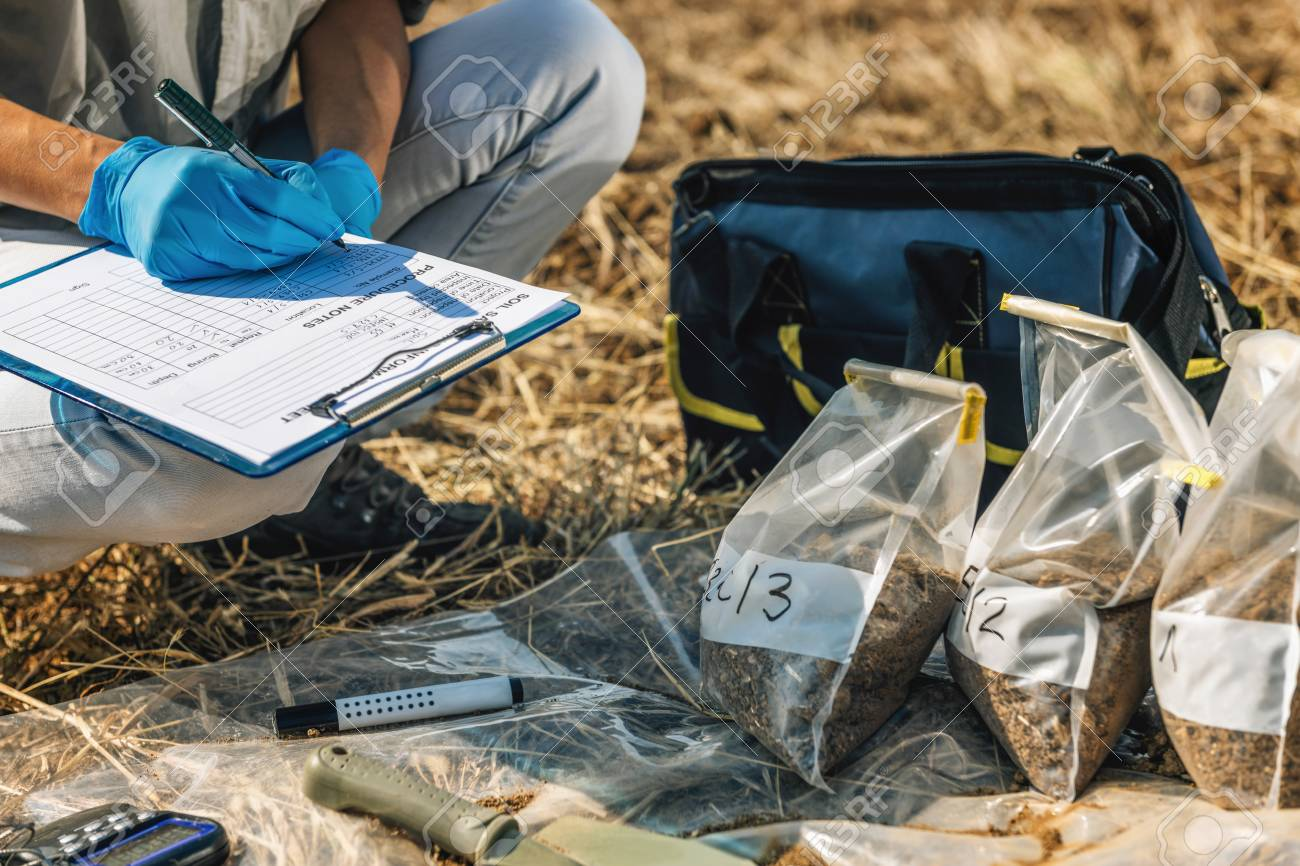 Soil Test. Female agronomist taking notes in the field. Environmental protection, organic soil certification, research - 117749882