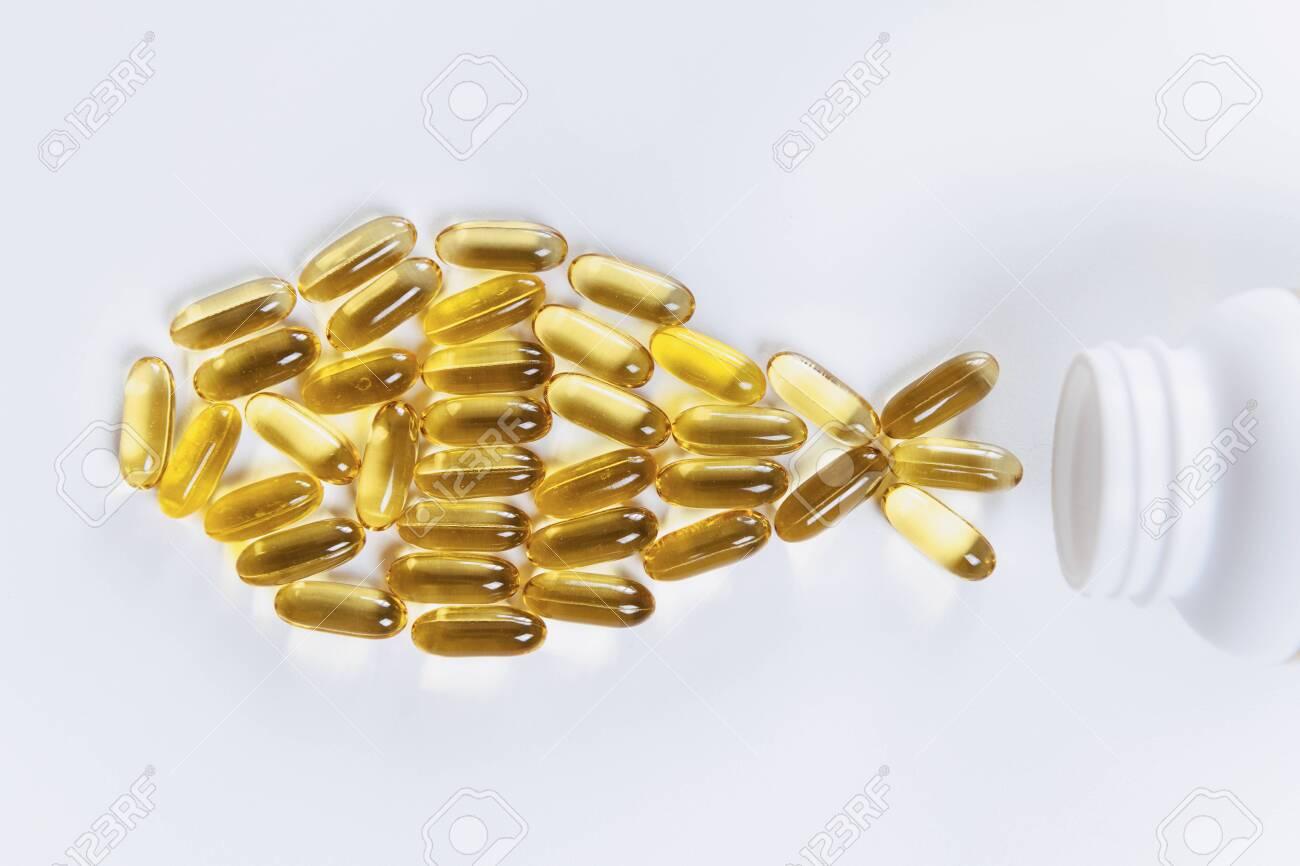 Omega 3 supplements. Softgel supplement capsules, fish shape - 118587198