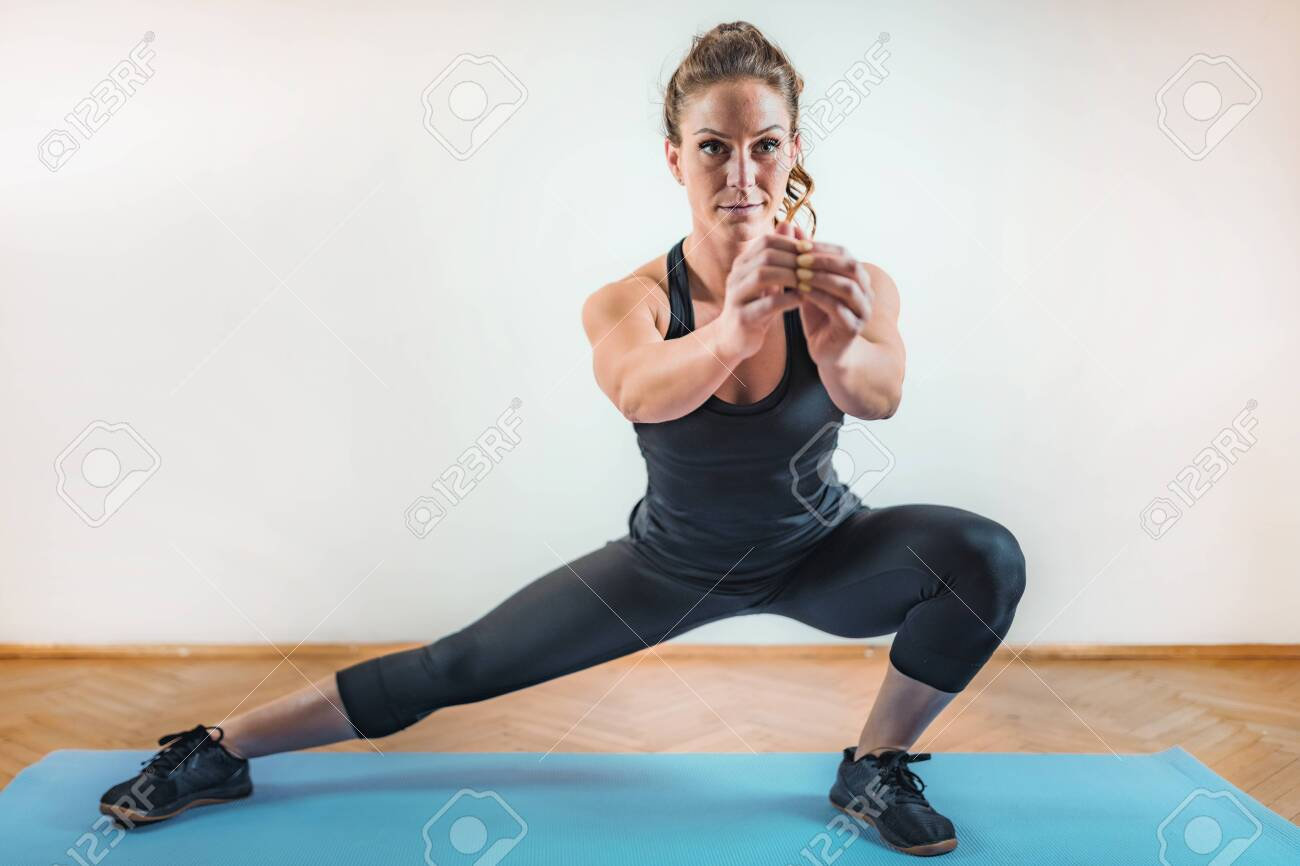 Side Lunges Exercise. HIIT or High Intensity Interval Training Indoor - 127981376