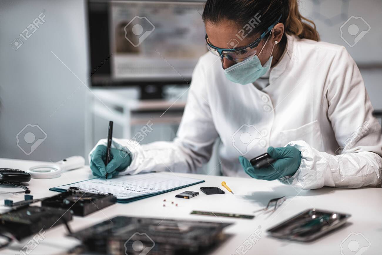 Digital Forensic Science Police Forensic Analyst Examining Confiscated Stock Photo Picture And Royalty Free Image Image 131481091