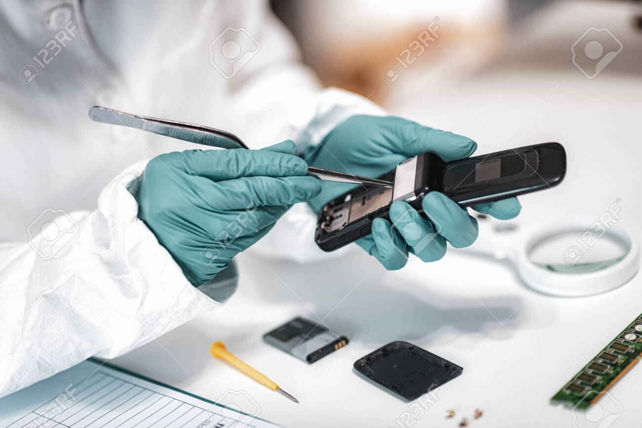 Digital Forensic Science Police Forensic Analyst Examining Confiscated Stock Photo Picture And Royalty Free Image Image 131481093