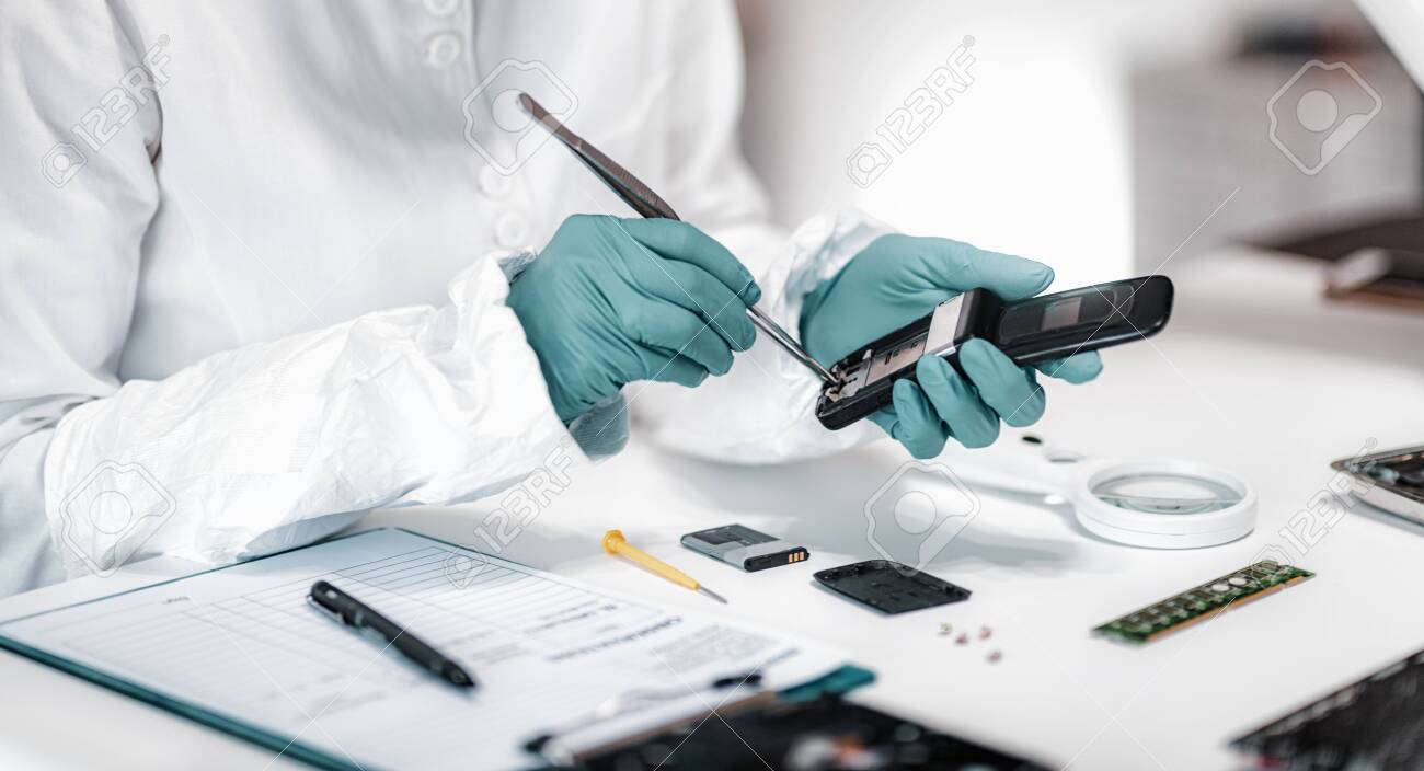 Digital Forensic Science Police Forensic Analyst Examining Confiscated Stock Photo Picture And Royalty Free Image Image 131481177