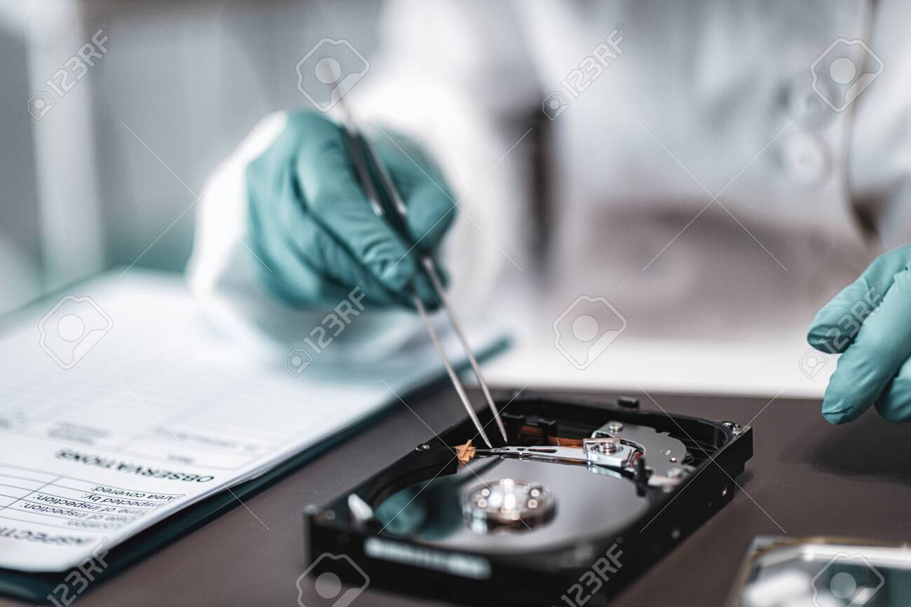 Digital Forensic Science Police Forensic Analyst Examining Computer Stock Photo Picture And Royalty Free Image Image 131481065