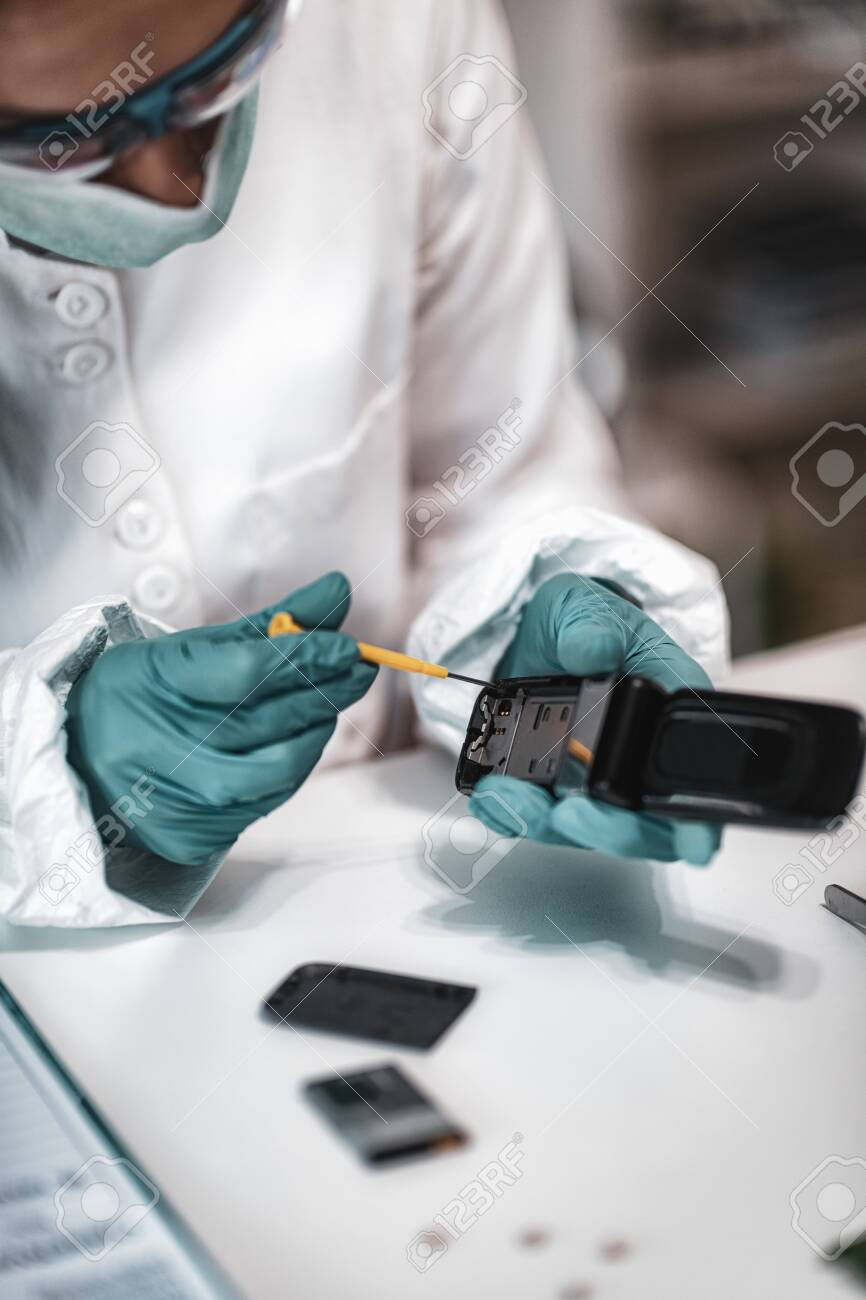 Digital Forensic Science Police Forensic Analyst Examining Confiscated Stock Photo Picture And Royalty Free Image Image 131481070