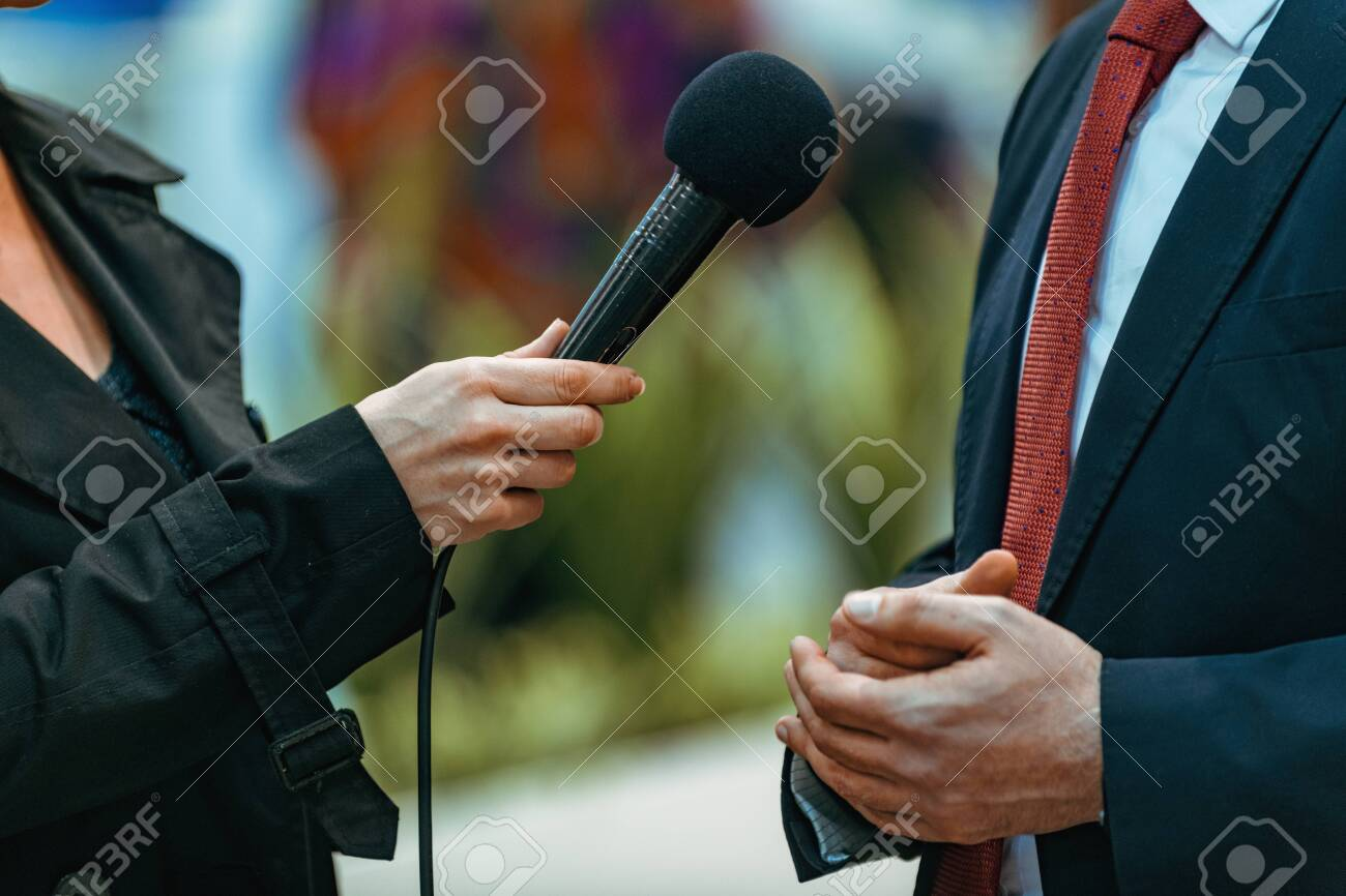 Journalists holding microphone and dictaphone, interviewing businessman speaker. - 135225168