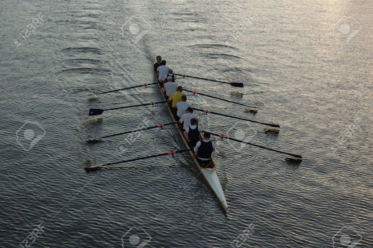 Early morning rowers training on the river. - 893308