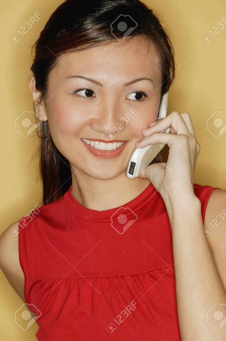 071e6dcd10b6e0 Young Woman Wearing A Red Top, Using A Mobile Phone Stock Photo ...