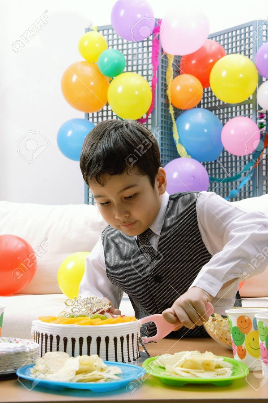 Remarkable Boy Cutting Birthday Cake Stock Photo Picture And Royalty Free Funny Birthday Cards Online Inifodamsfinfo
