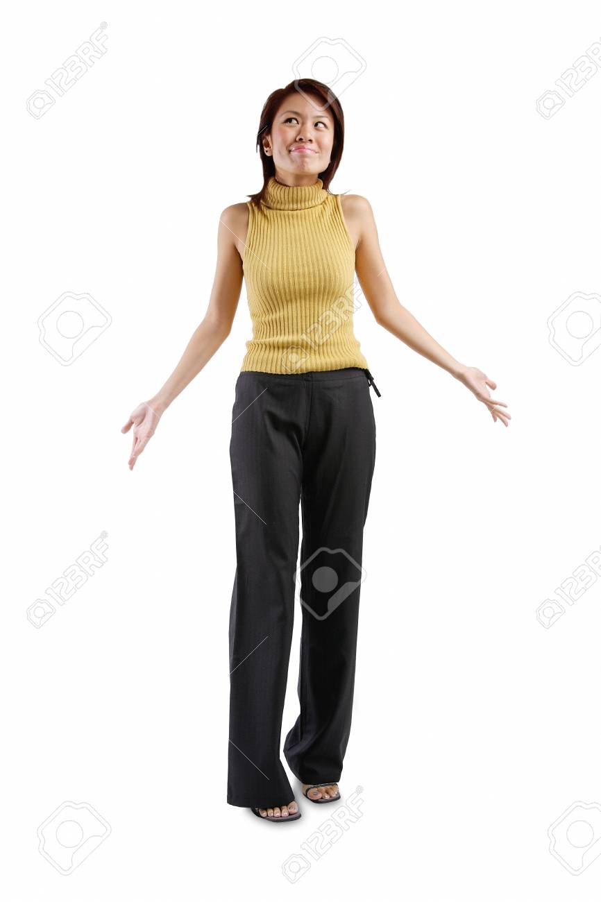 Stock photo young woman standing hands at her side palms up