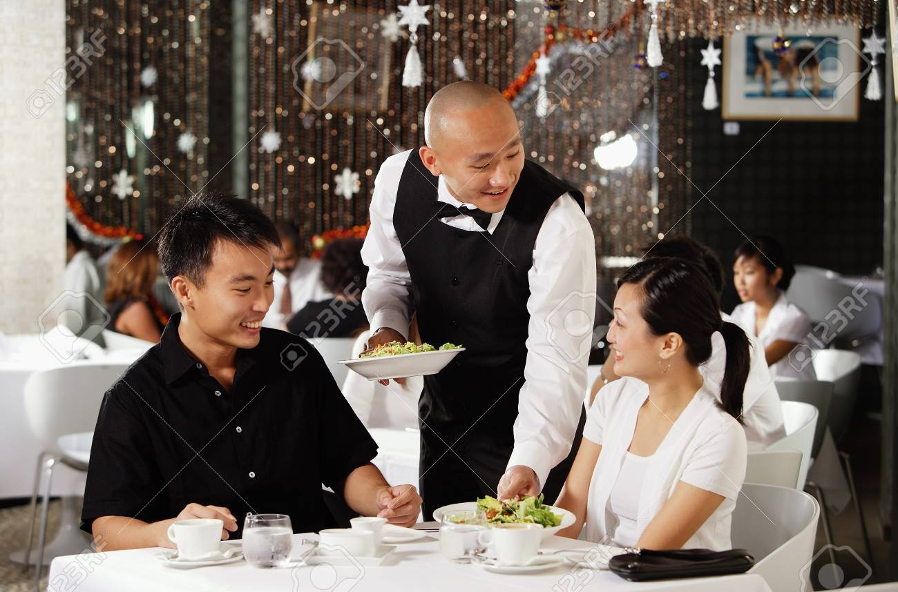 Waiter Serving Couple At Restaurant Stock Photo Picture And Royalty Free Image Image 69308104