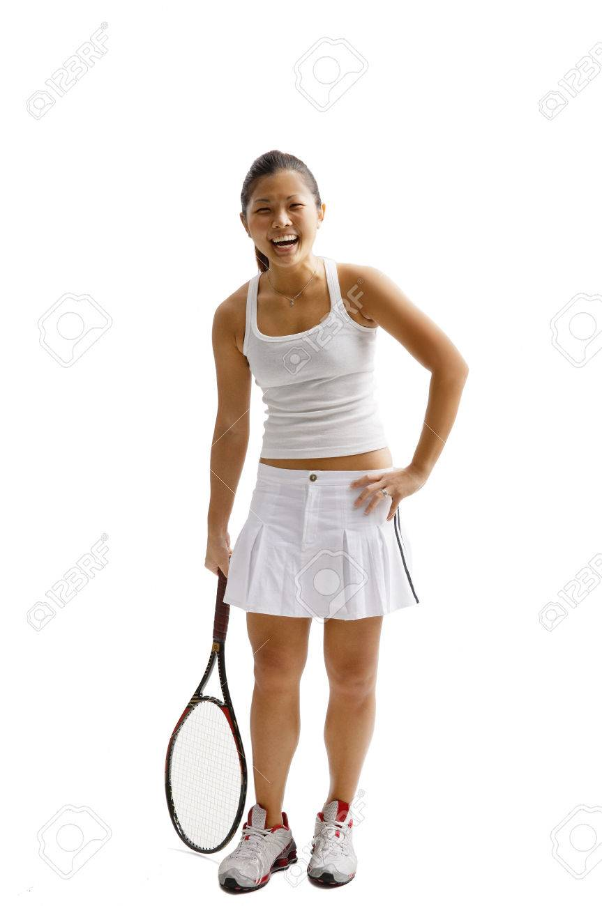 Young Woman In Tennis Outfit Standing With Tennis Racket Stock Photo Picture And Royalty Free Image Image 69312756