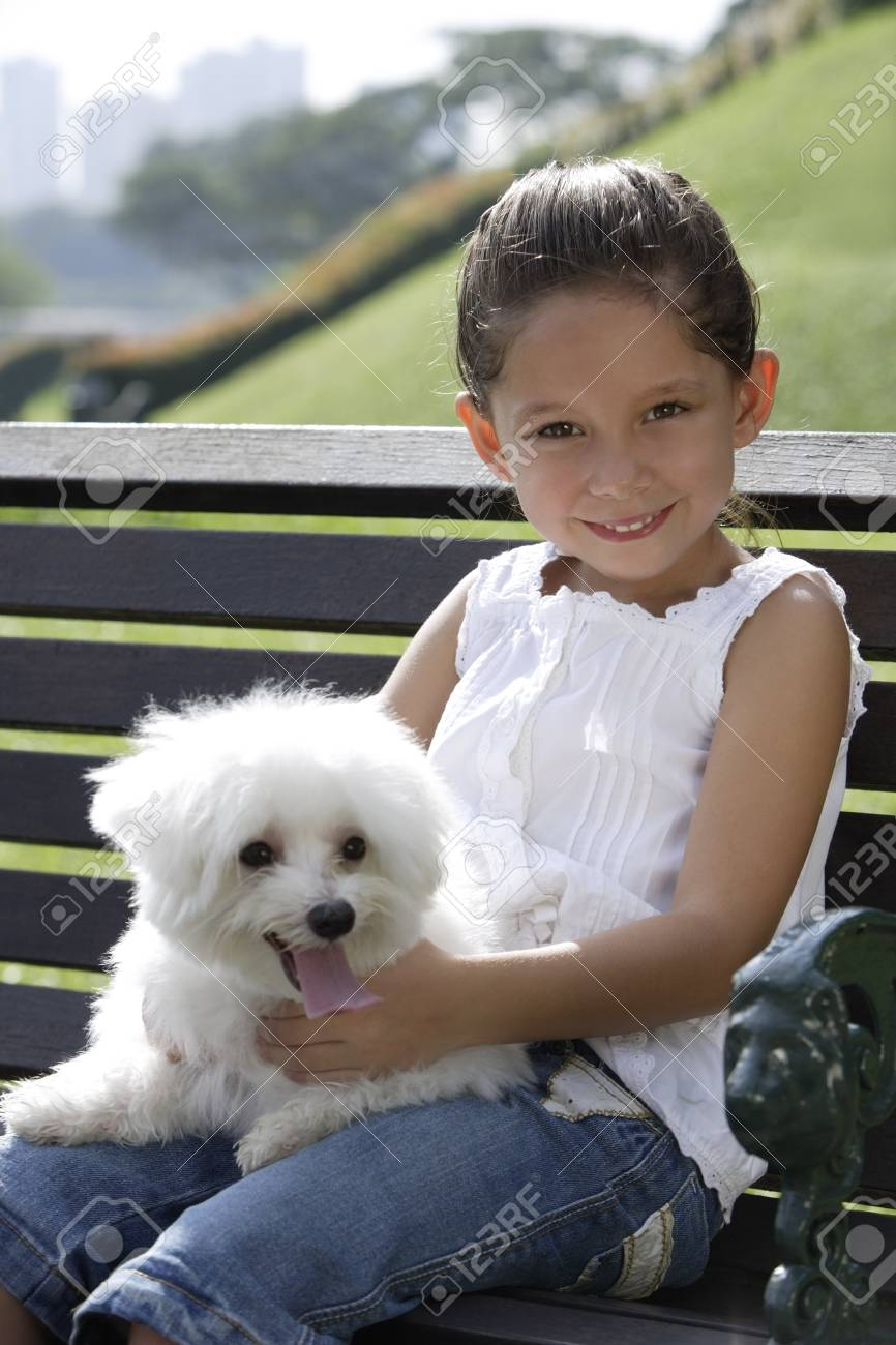 Young Girl Holding Puppy On Her Lap Stock Photo Picture And Royalty