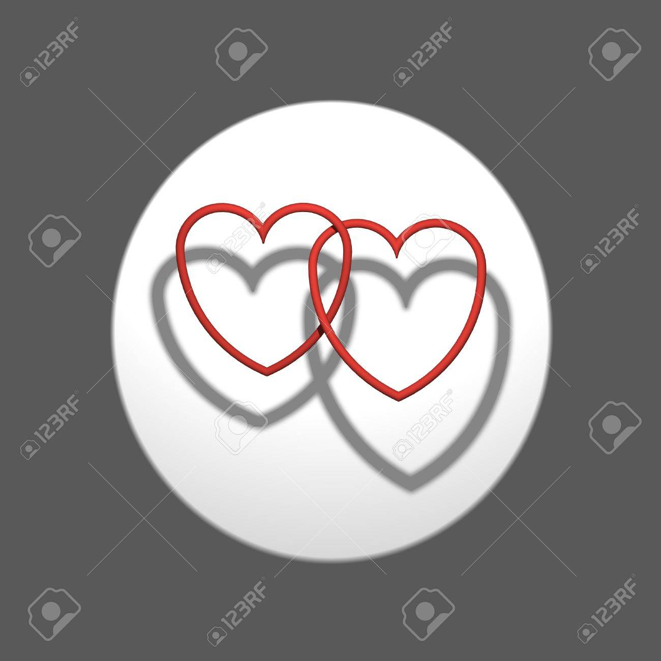 Two intertwined hearts projecting the shadow on background Stock Photo - 13812370