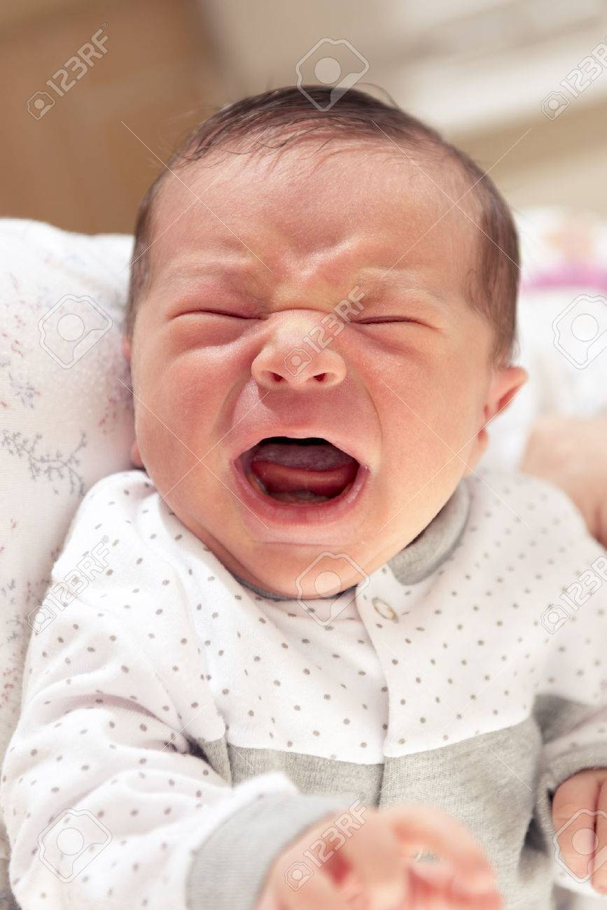 Cute new born baby crying loudly with facial gesture stock photo 22672876