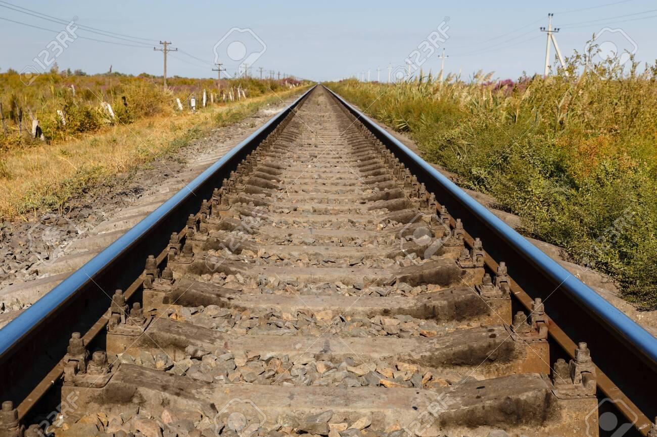 single-track railway line, rails and sleepers, railway track in Kazakhstan - 135794423
