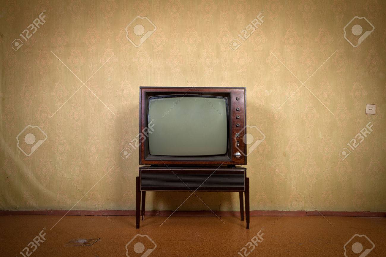 Retro TV On A Background Of Vintage Wallpaper In Old Room With Vignetting Stock Photo