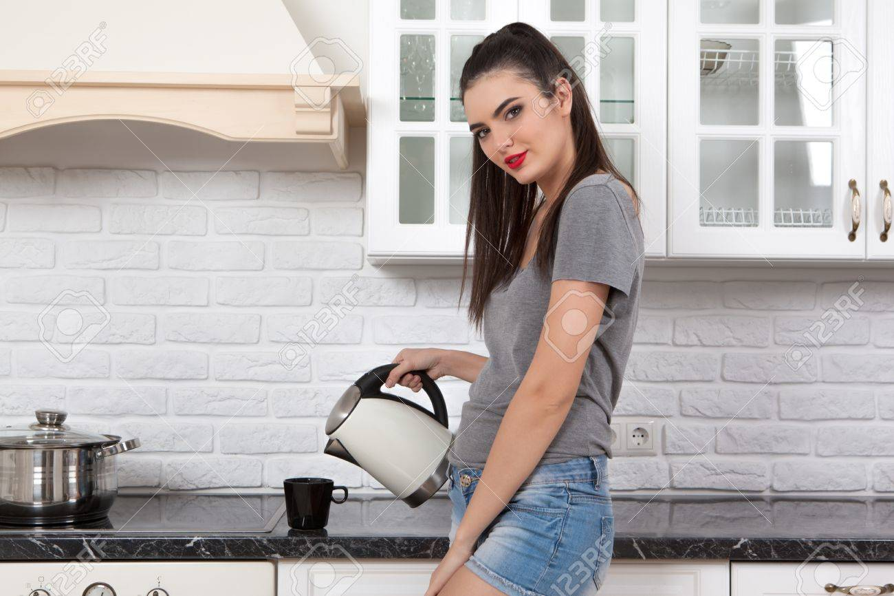 Young Beautiful Slim Girl Standing In The Kitchen Preparing Coffee ...