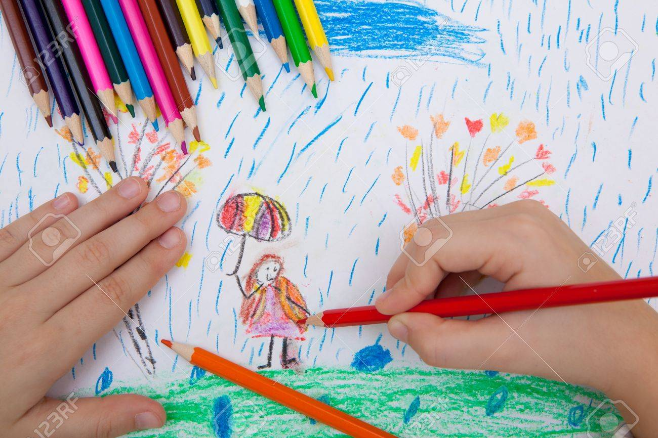Stock photo the child draws a pencil drawing of a girl with an umbrella in the rain