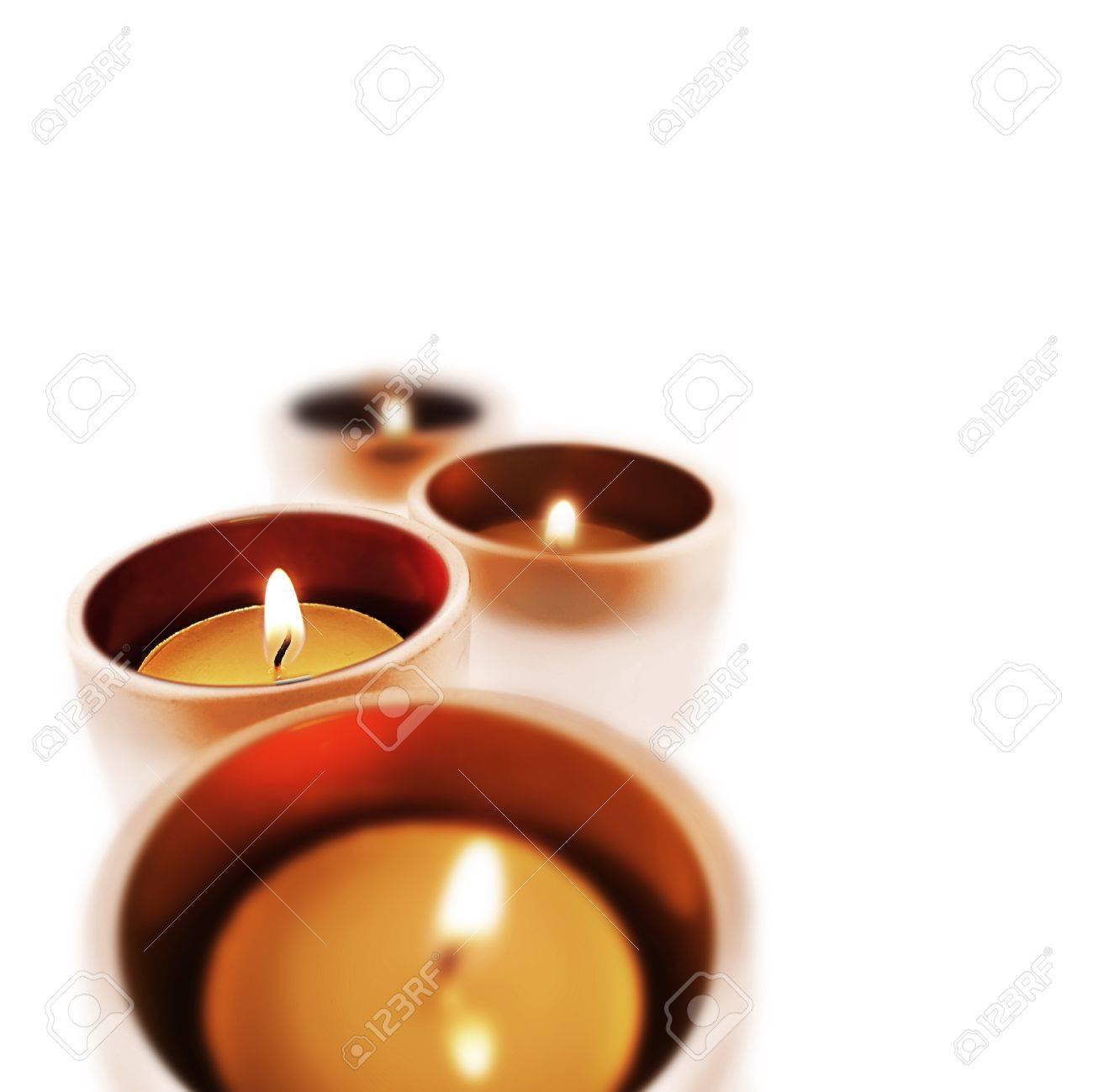 Cuatro equipaje de mano que guarda de cristal con velas encendidas Foto de archivo - 13343702