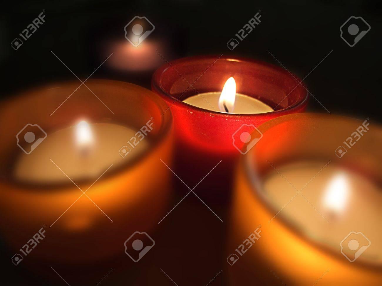 Cuatro porta-velas de cristal con velas encendidas. Four carry-you guard of crystal with ignited candles. Stock Photo - 13418569