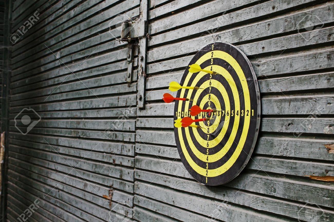 Dartboard on wood wall Stock Photo - 10316666