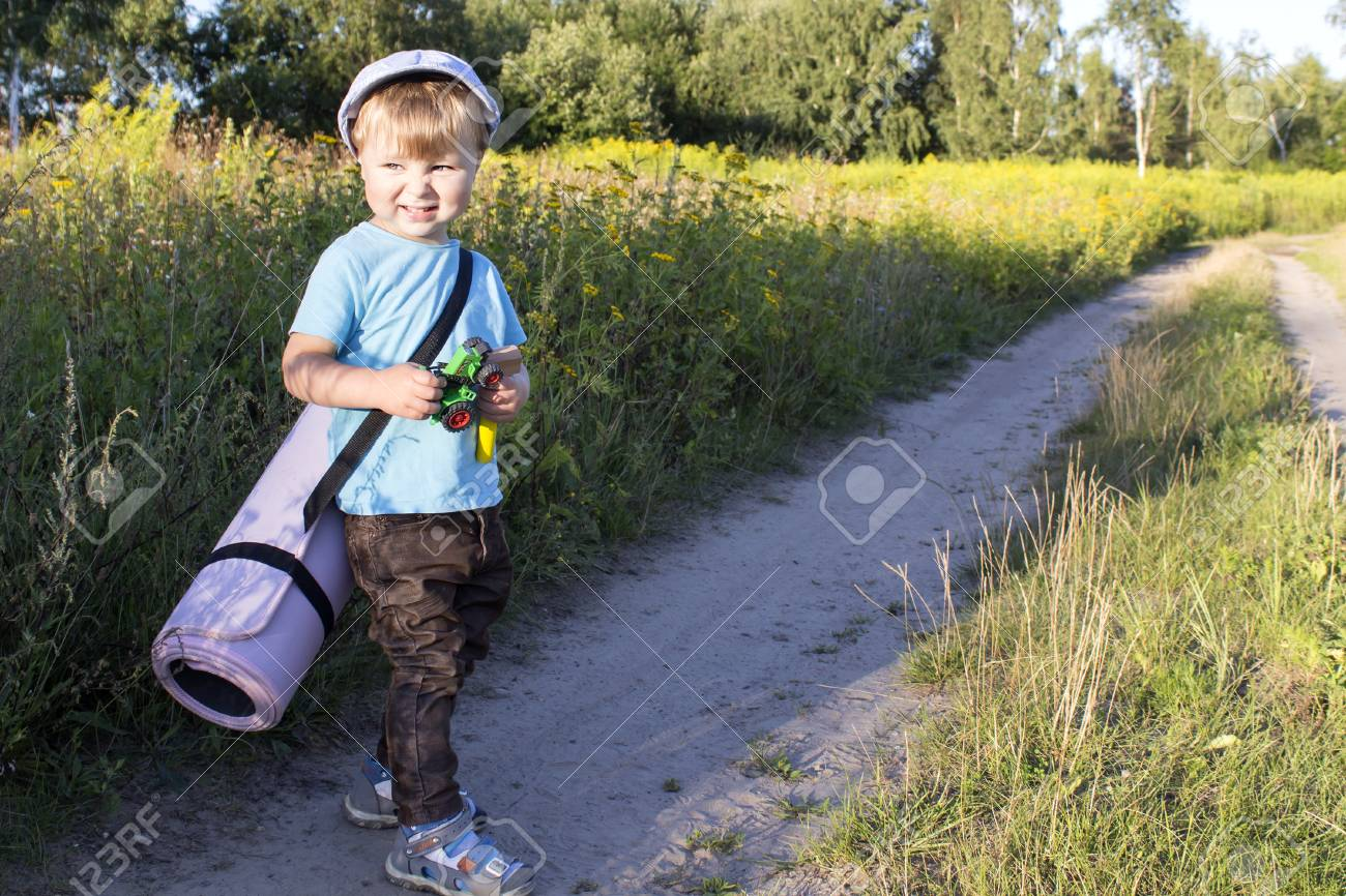 A Young Boy Goes In Search Of Adventure. Stock Photo, Picture And ...