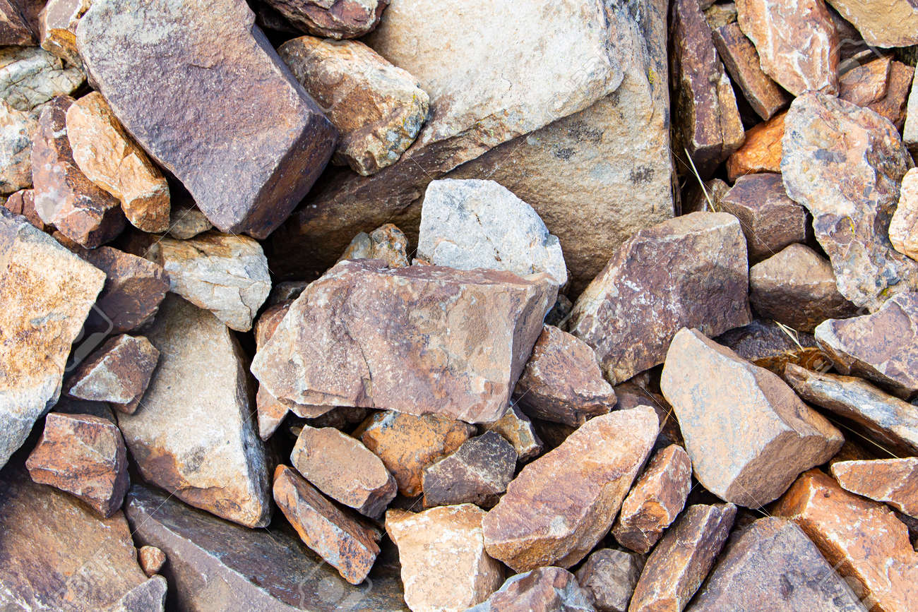 Rockfall on the road in the mountains. Stones of different sizes. Landslides - 173195739