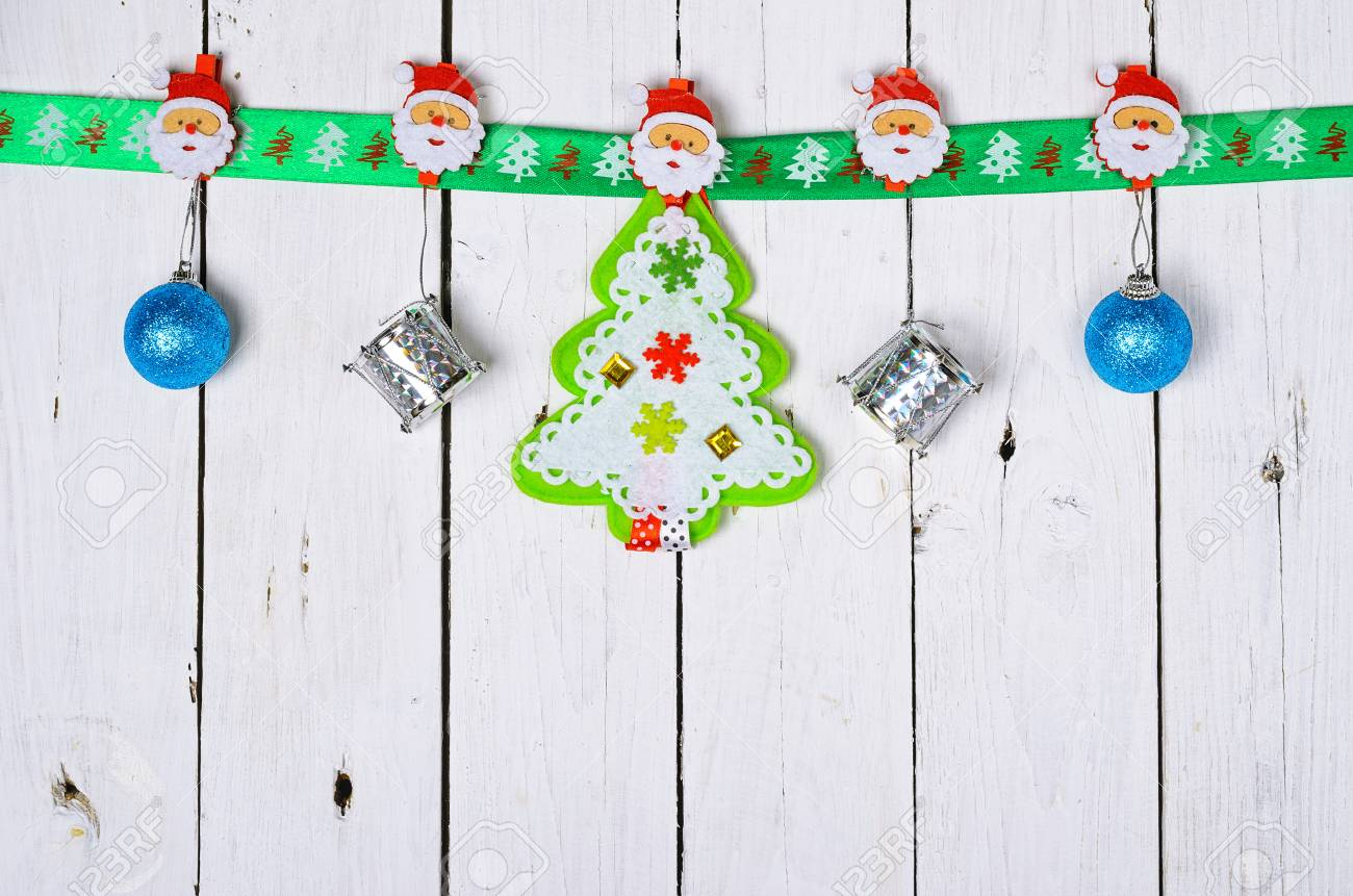 Christmas Decorations Hanging On A Wooden Background. Design.. Stock ...