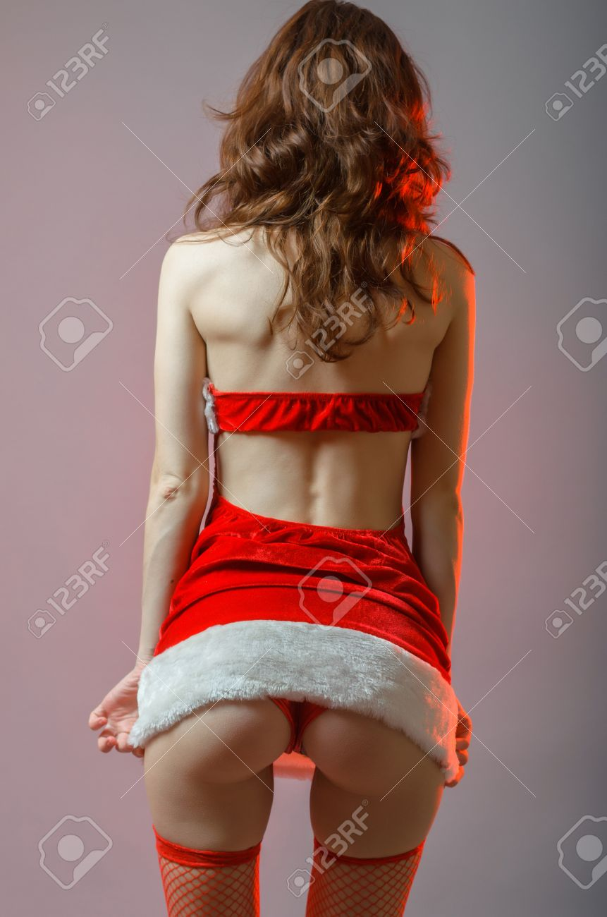 Stock Photo Young And Sexy Santa Girl With A Big Ass Woman In Suit Snow Maiden New Years Image Gray Background With Red Illumination