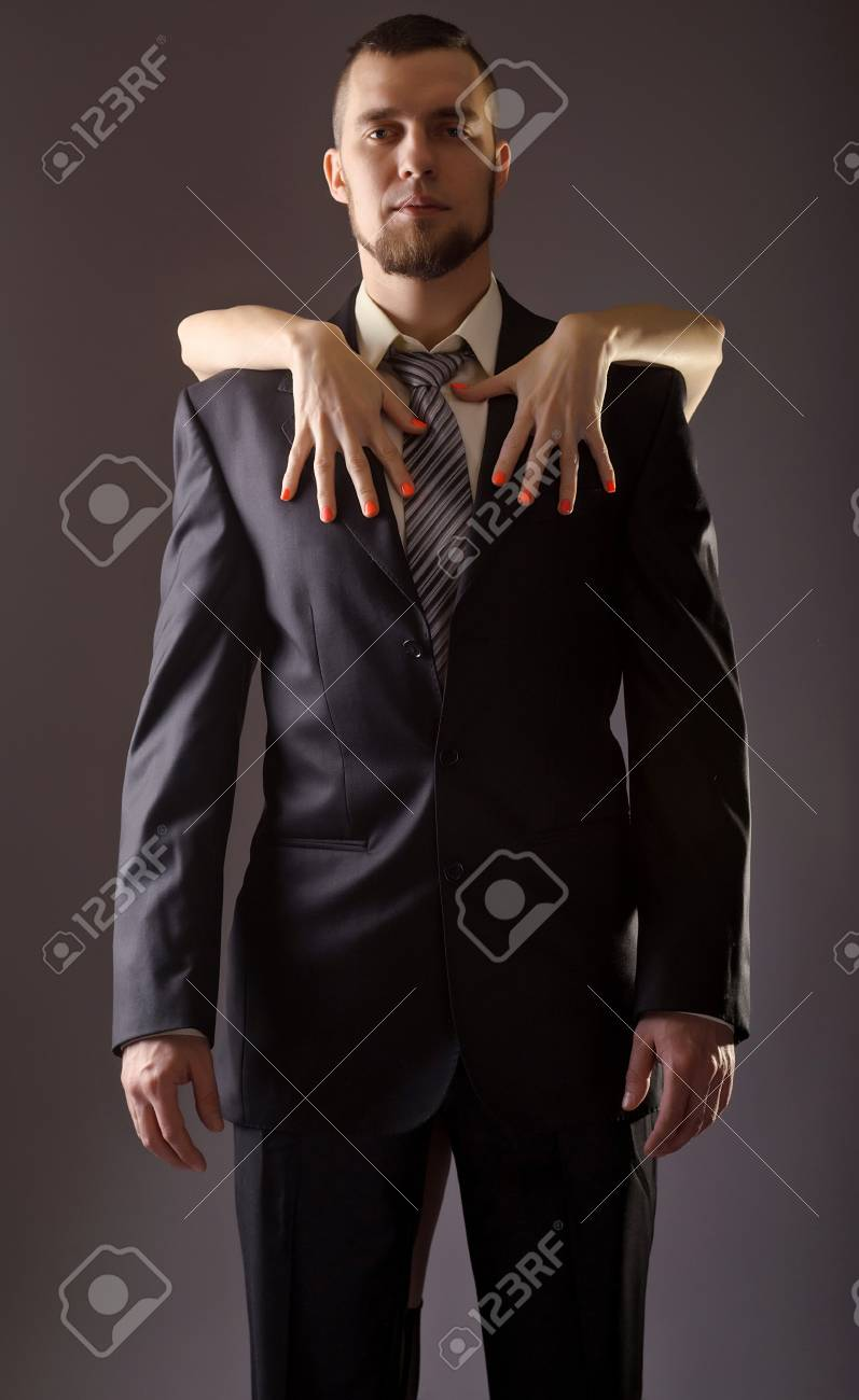 A Bearded Man In A Suit And The Woman\'s Hand With Red Nail Polish ...