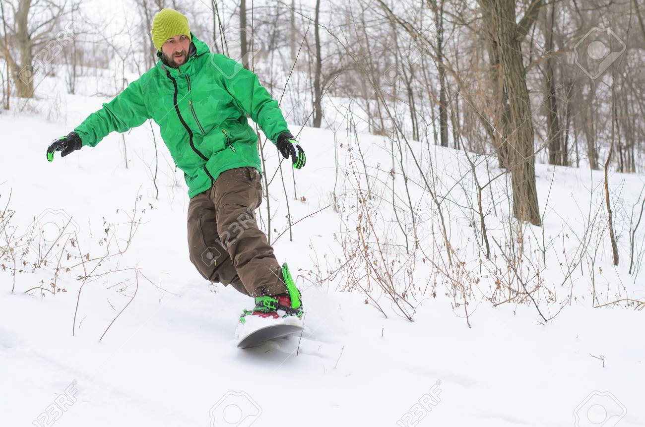 Active Man Snowboarding Winter Sports A Man Riding On A Snowboard