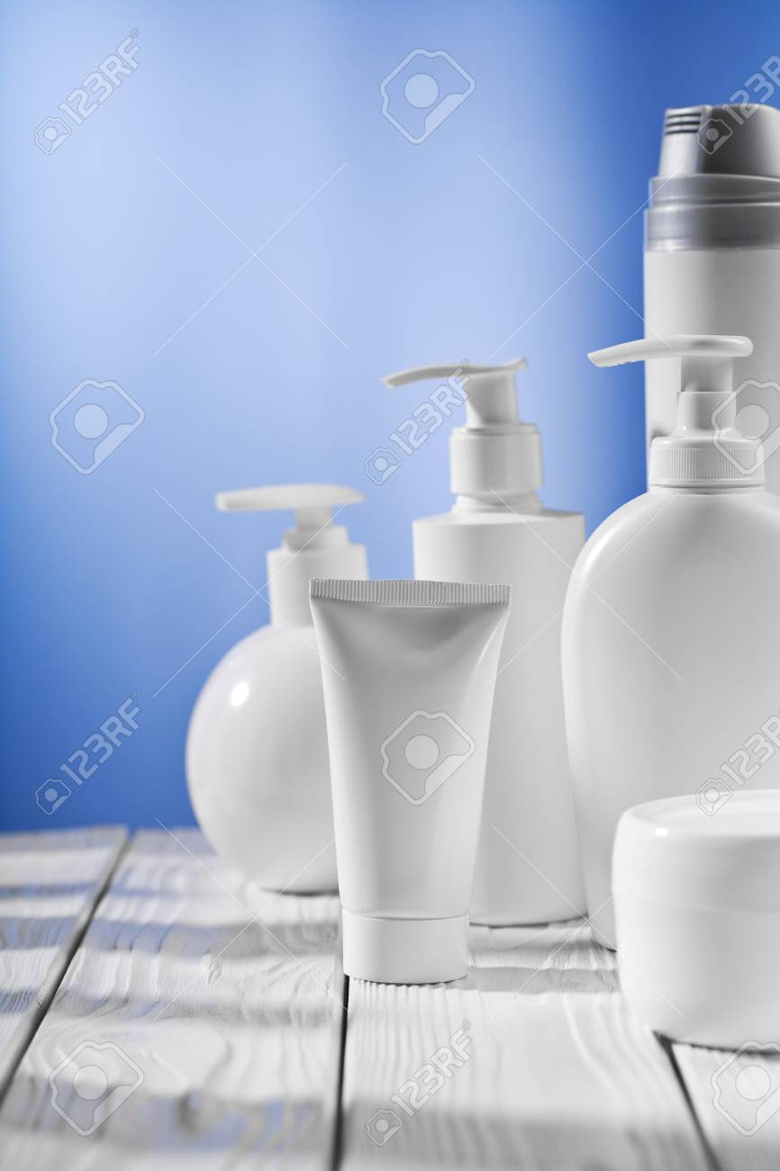 white skincare items on wooden table Stock Photo - 14164097