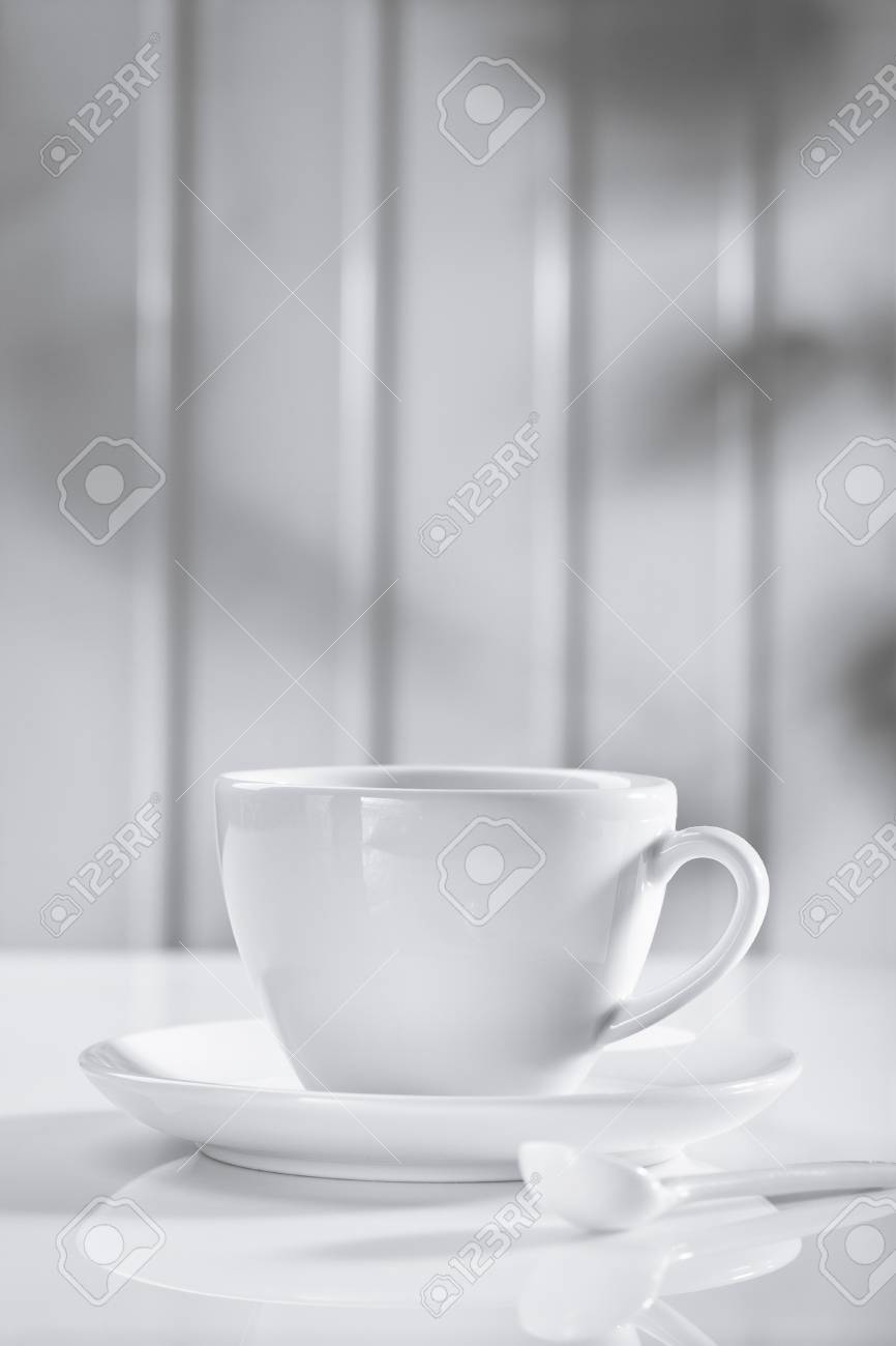 ceramic coffee cup with spoon on white Stock Photo - 14356411