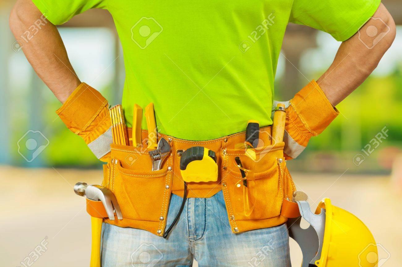 tools in belt of worker - 21687155