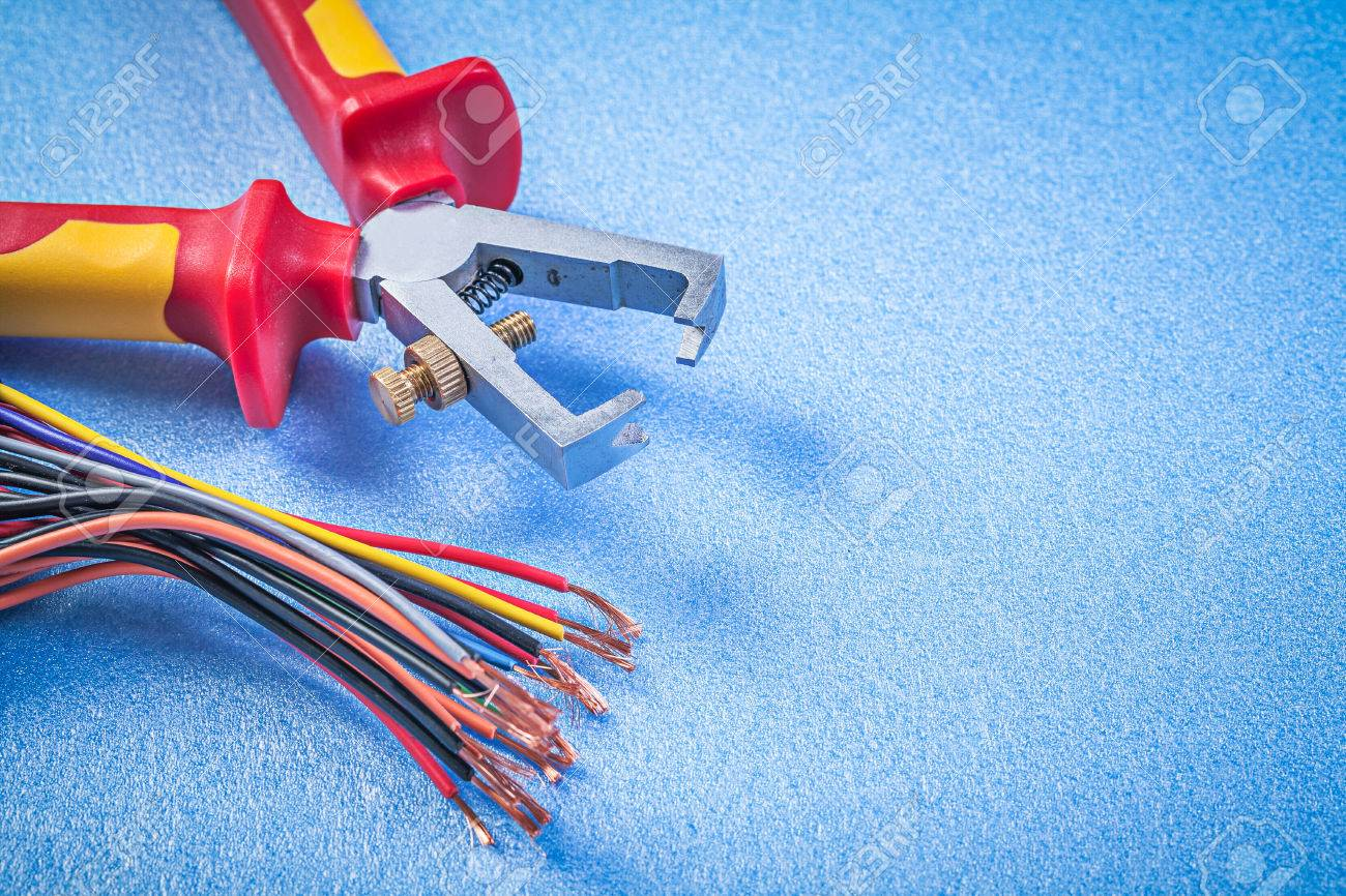 Insulated Wire Strippers And Electric Cables On Blue Background ...