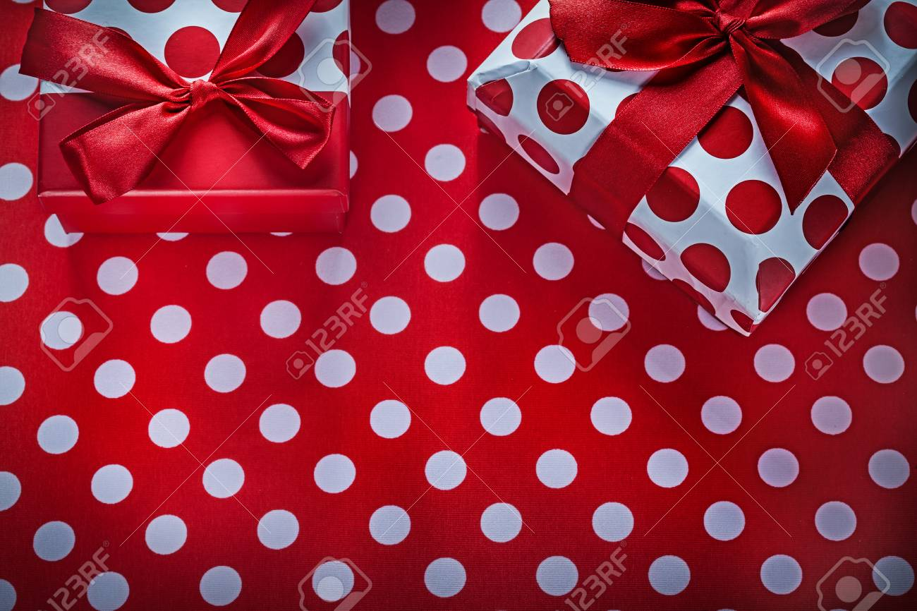 present boxes on polka dot red print background holidays concept