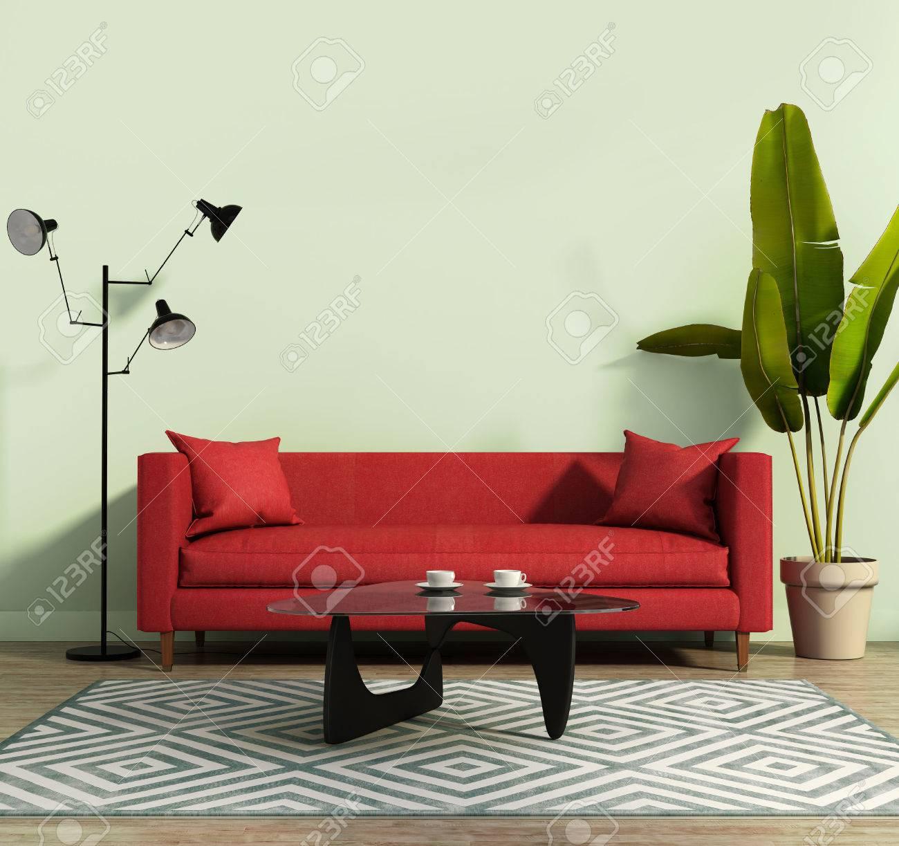赤いソファと幾何学的なラグ付きのリビング ルーム ロイヤリティーフリー