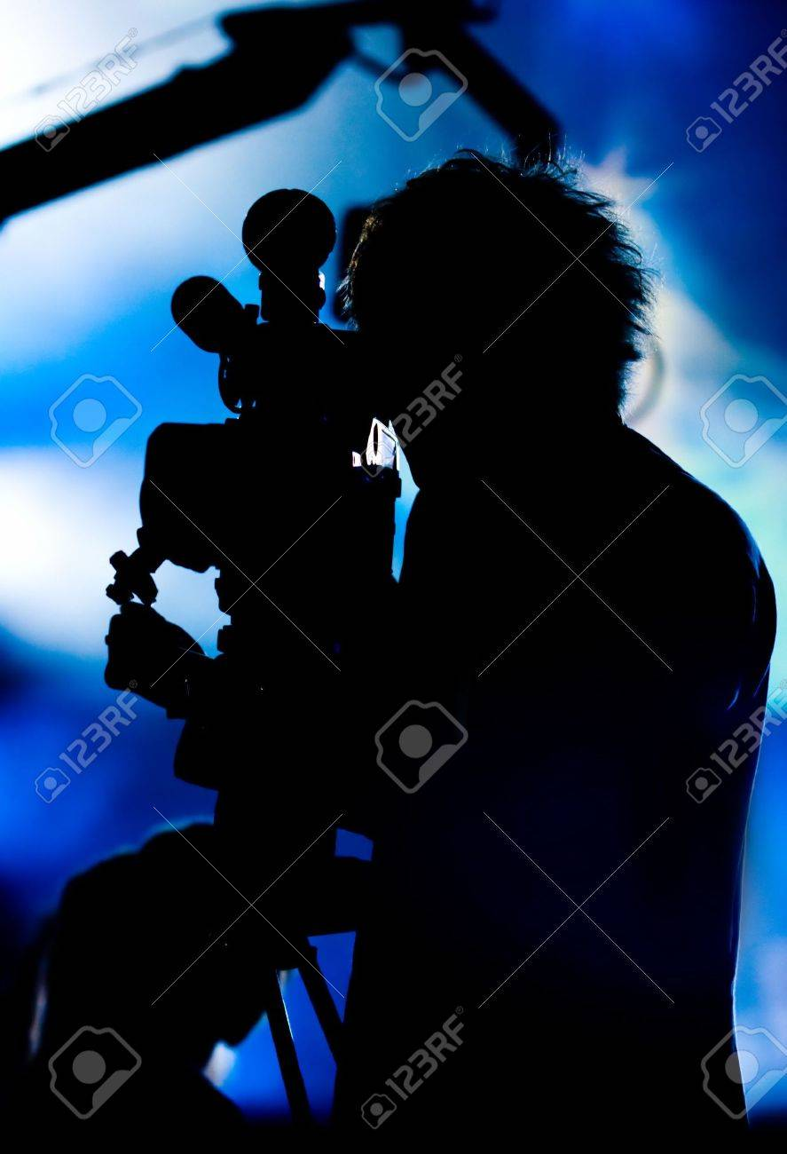 Silhouette of a cameraman filming fashion show catwalk Stock Photo - 3141266