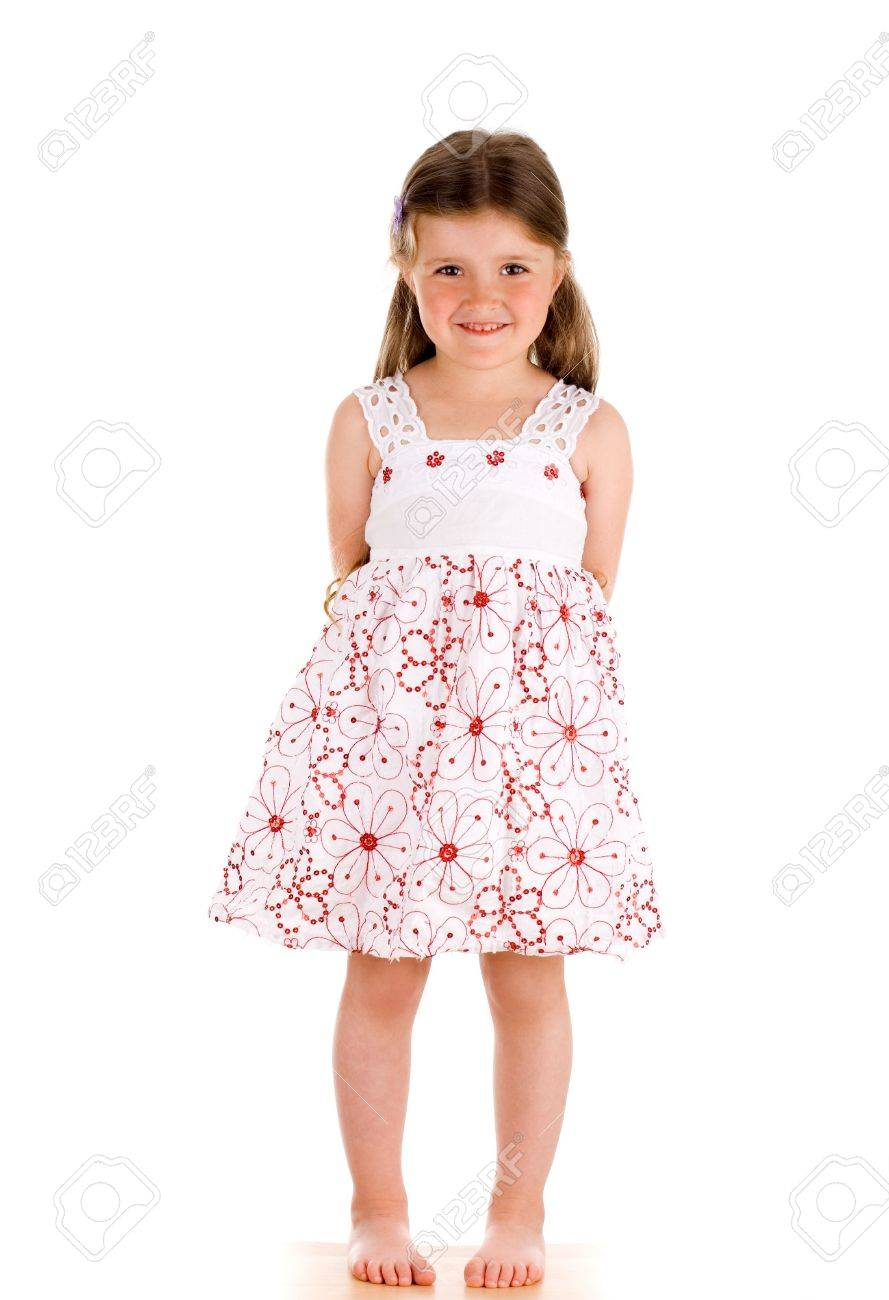 Little innocent girl on isolated background with hands behind her back Stock Photo - 3294347