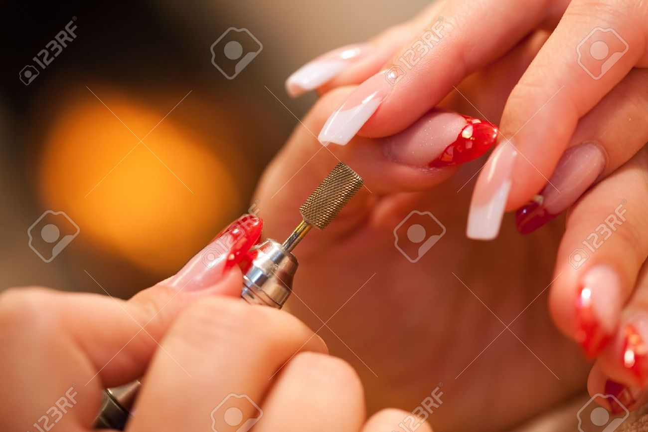 Macro closeup of nail polisher at work on french nails Stock Photo - 5452209