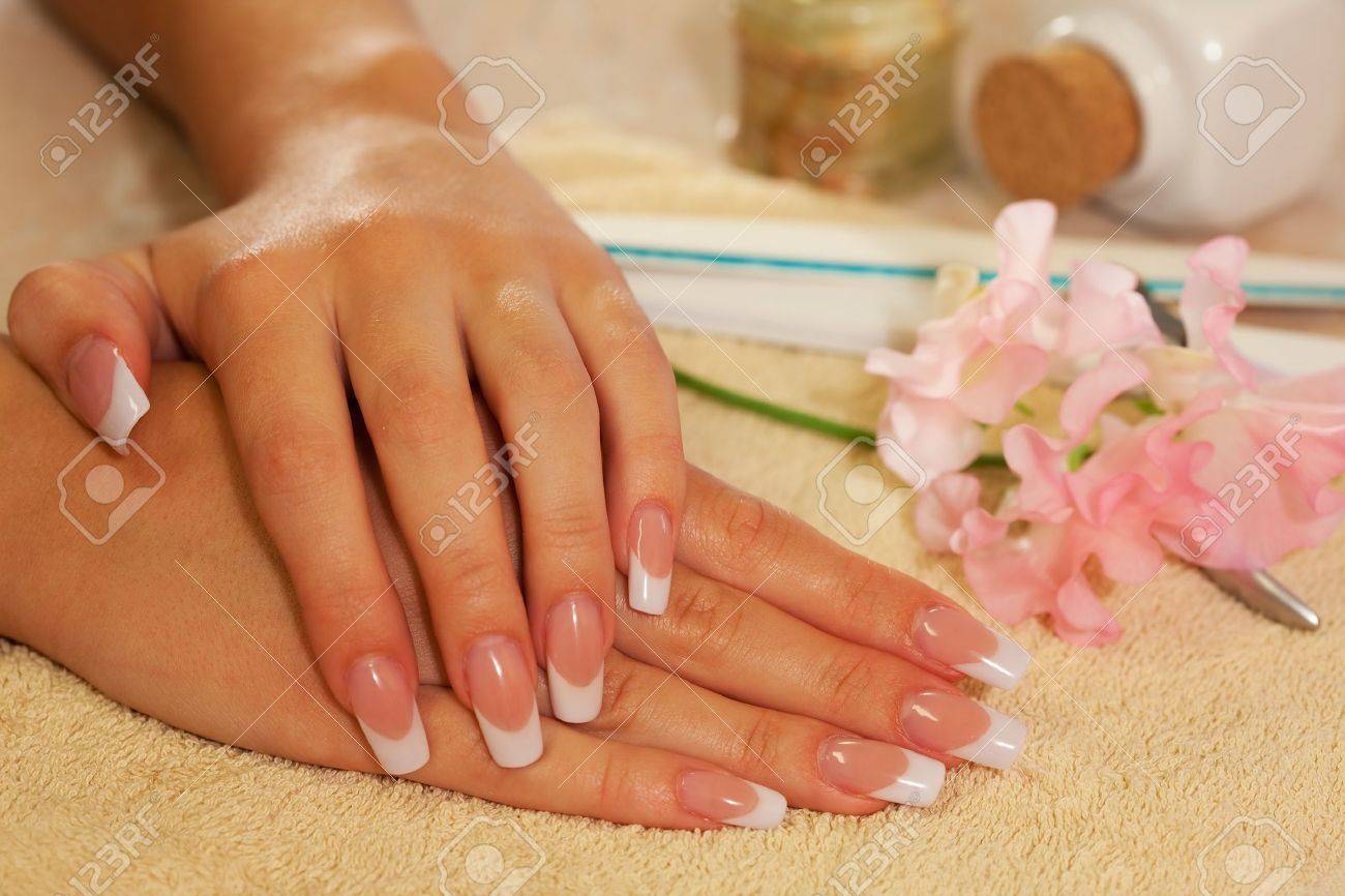 Hands of young woman with french manicure on the towel Stock Photo - 5452235