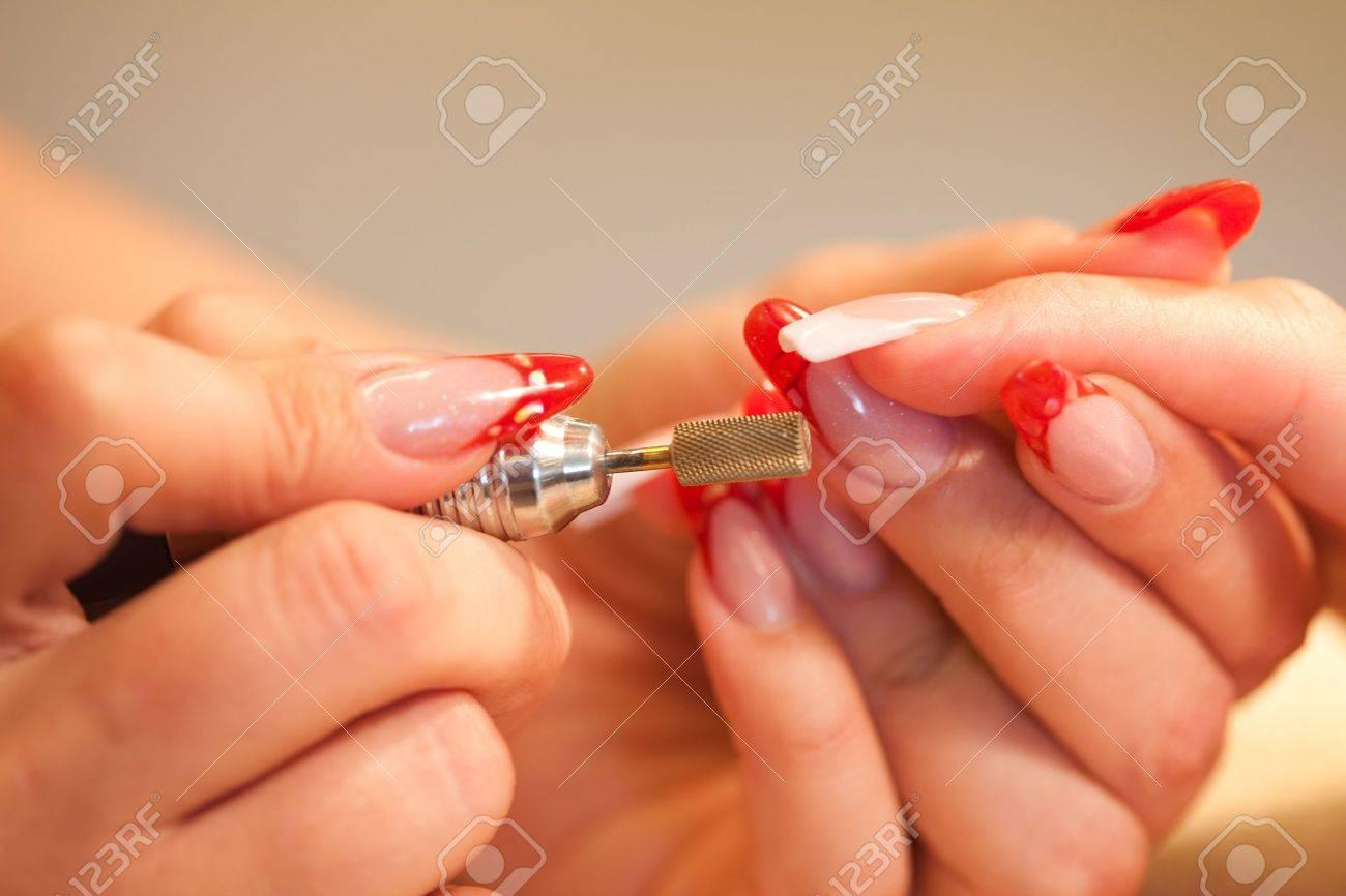 Macro closeup of nail polisher at work on french nails Stock Photo - 5734294