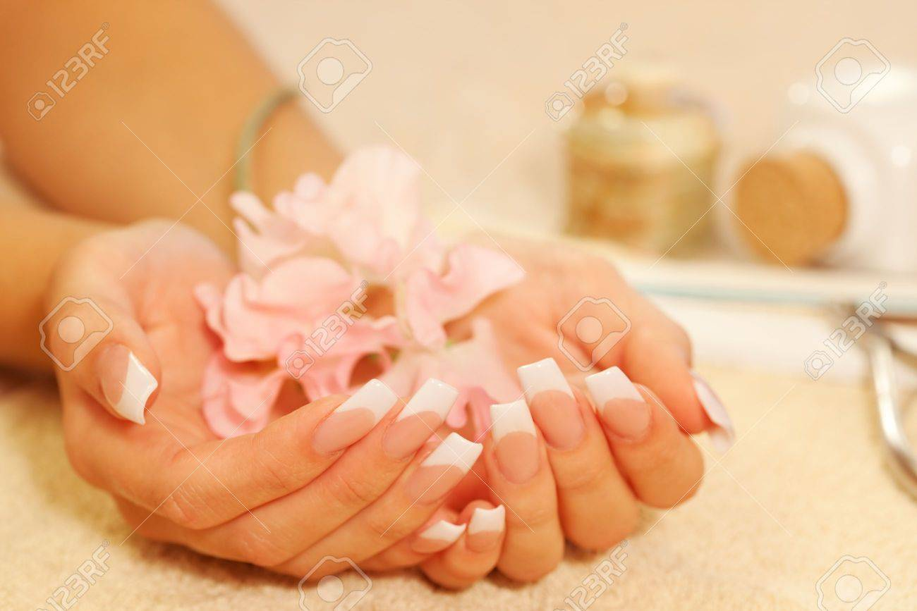 Hands of young woman with french manicure on the towel Stock Photo - 5816579