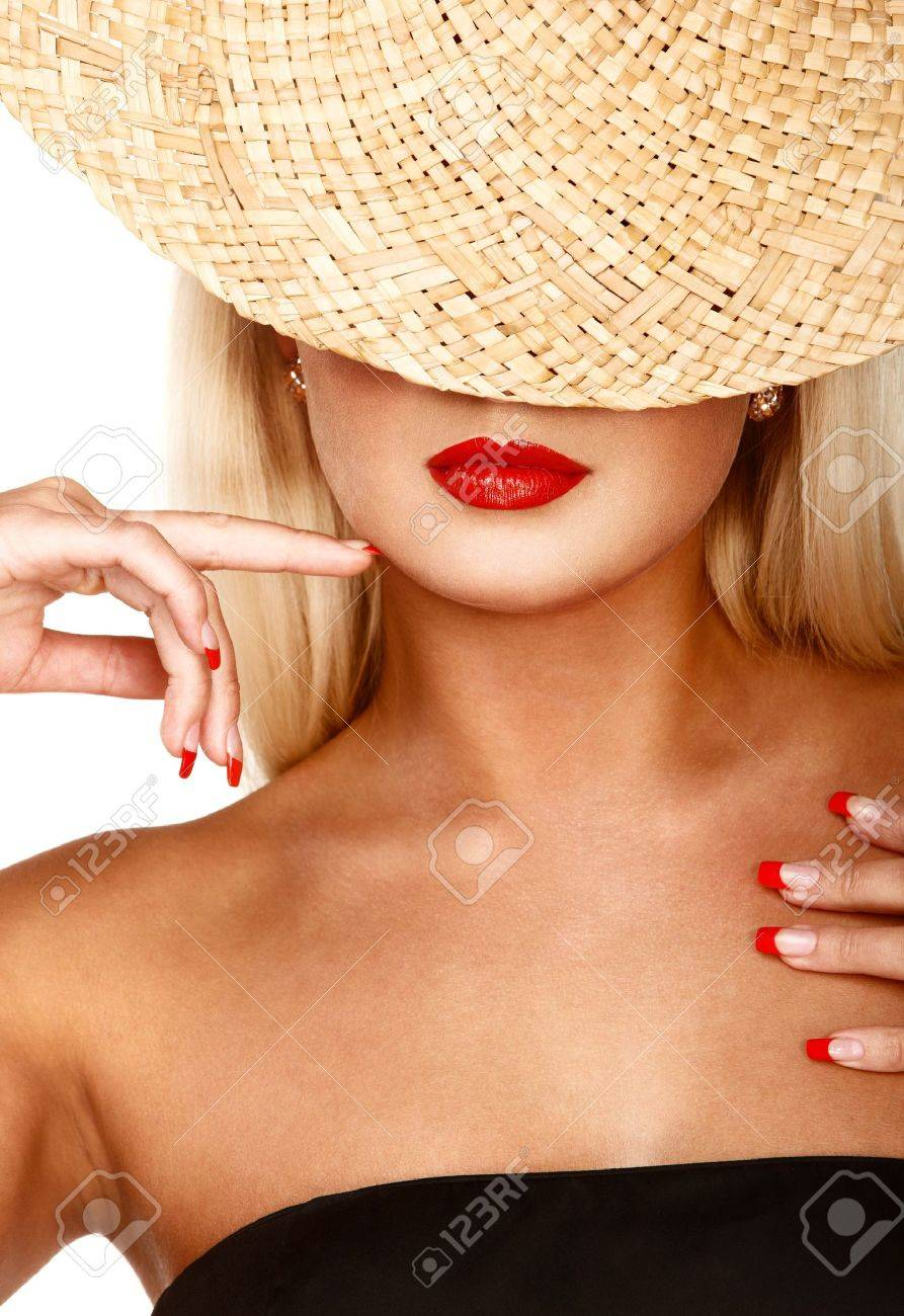 Portrait of anonymous woman in straw hat over isolated white Stock Photo - 6715881