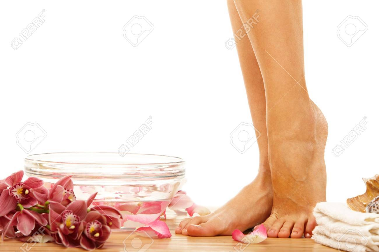 Foot of young woman om therapy event with flowers Stock Photo - 6746743
