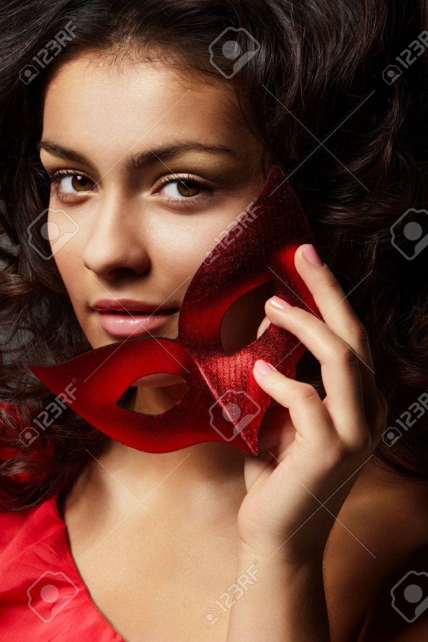 Portrait of young beautiful woman with with red carnival mask Stock Photo - 8204082