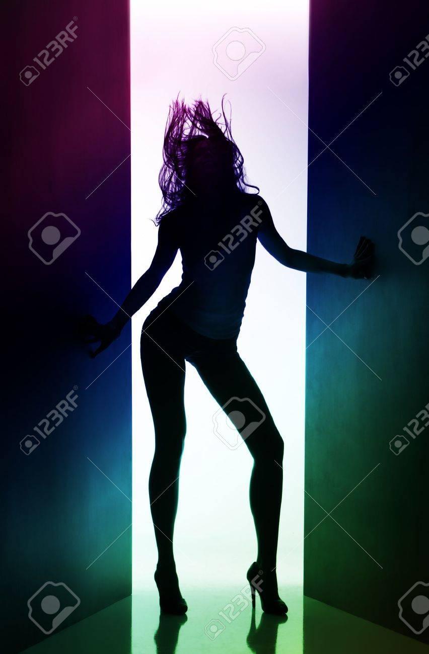 https://previews.123rf.com/images/mihhailov/mihhailov1101/mihhailov110100043/8769318-silhouette-of-dancing-girl-between-black-curtains.jpg