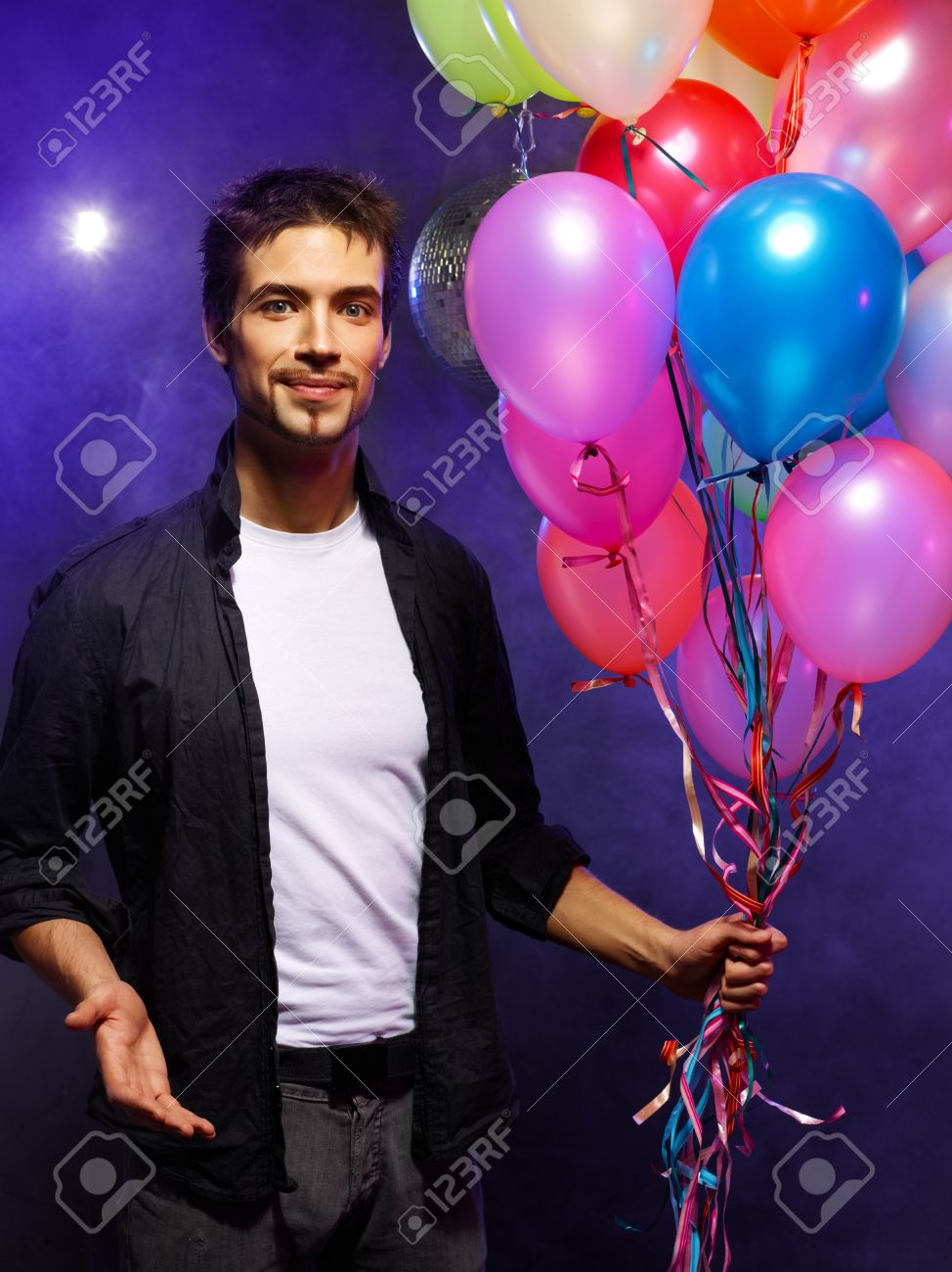 Handsome Man Holding Bunch Of Air Balloons Stock Photo